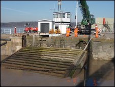 The old gates being removed