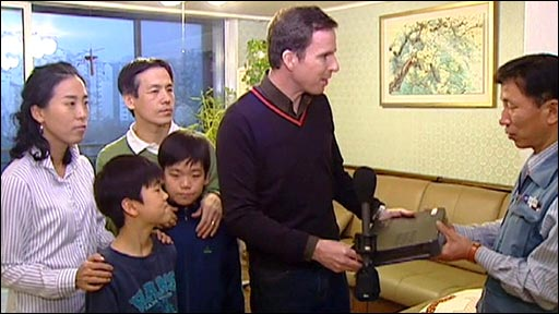 The families brace themselves as a Korea Telecom engineer takes away their modems