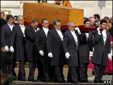 The coffin of Pope John Paul is carried in 2005