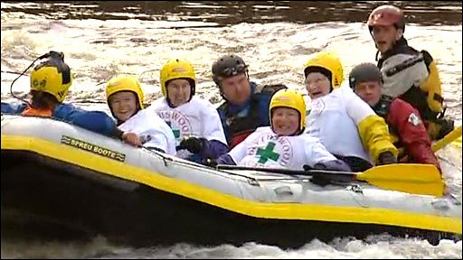 Gean Hodsdon (third from right) white-water rafting
