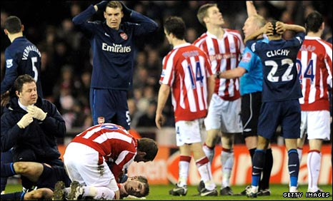 Arsenal's Aaron Ramsey lies injured after the tackle by Stoke's Ryan Shawcross