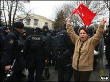 A protester holds a Turkish flag during a demonstration in front of the US embassy in Ankara, 5 March