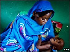 A woman holds her young baby in Goz Beida, eastern Chad, file pic