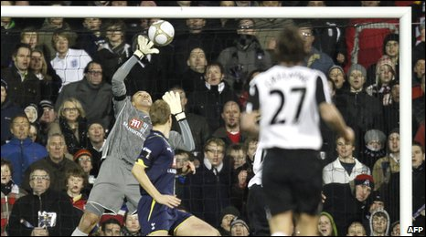 Tottenham goalkeeper Heurelho Gomes saves from Zoltan gera