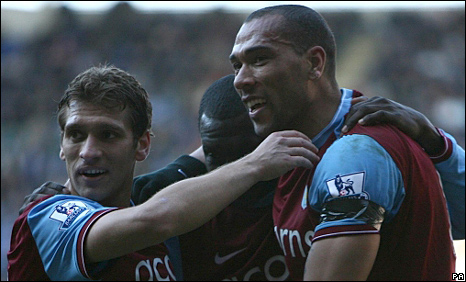 Aston Villa celebrate after John Carew's second goal