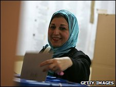 A woman votes in Iraq