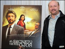 Juan Jose Campanella stands by a poster for his film The Secret in Their Eyes