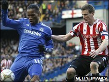 er Robert Huth challenges Didier Drogba of Chelsea