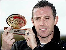Rangers defender David Weir shows off his award