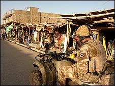 UK soldier patrolling on quad bike
