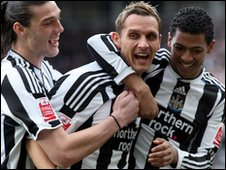 Peter Lovenkrands and team-mates celebrate a Newcastle goal