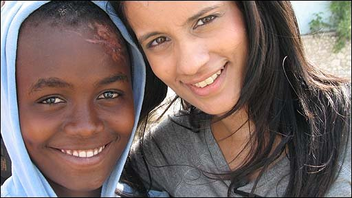 Sonali and child in Haiti