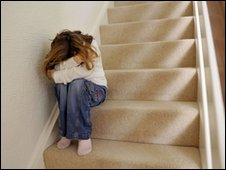 Bullied girl on stairs. generic