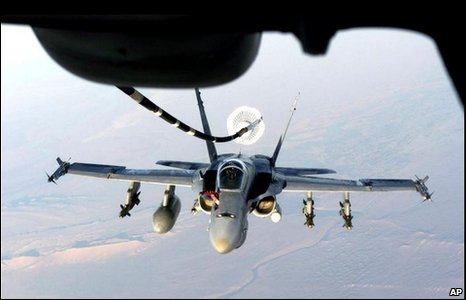 Navy F/A-18 Hornet prepares to take on fuel from a US Air Force KC-10 while flying in 2001