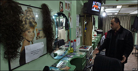 A male Palestinian hairdresser at his salon for women in Gaza City 