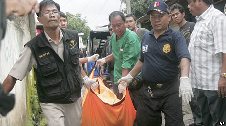 Police and medics carry the body of a suspected militant killed in a police raids in Jakarta. Photo: 9 March 2010