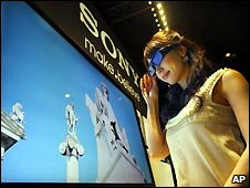 A model watches a new Sony TV with its 3-D glasses