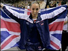 Britain's Beth Tweddle Tweddle holds a union flag after winning the gold medal in the women's individual apparatus final for the uneven bars during the World Gymnastics Championships at the NRGi Arena in Aarhus, Denmark, Friday Oct. 20, 2006.