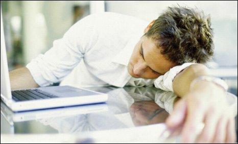 Man asleep at laptop