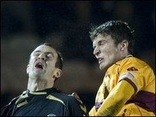 St Mirren defender John Potter and Motherwell striker John Sutton