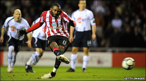 Darren Bent scores from the penalty spot