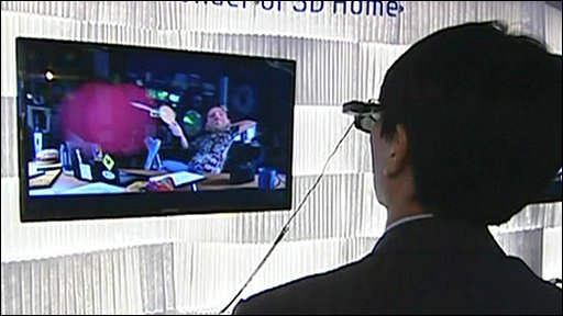 Man wearing 3D spectacles to watch television