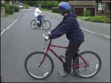 Teenage boys on bikes wearing cycle helmet