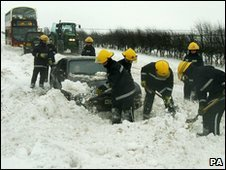 A fire crew digging out motorists in January