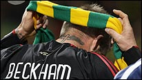 David Beckham puts on a green and gold scarf after the game at Old Trafford