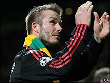 David Beckham wearing a green and gold scarf at the end of the game at Old Trafford