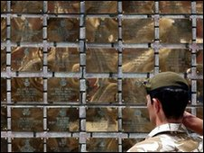 A British soldier salutes the plaques on the memorial wall in Basra