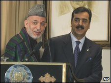 Afghan President Hamid Karzai (left) addresses a joint news conference with Pakistan's Prime Minister Yousuf Raza Gilani at the prime minister's official residence in Islamabad, Pakistan on Thursday, March 11, 2010