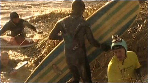 Surfers recover after riding the Severn Bore wave