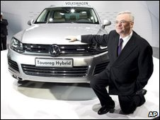 Martin Winterkorn, CEO of the Volkswagen group, poses in front of a VW Touareg Hybrid car