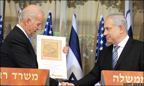 US Vice President Joe Biden accepts a gift from Israeli PM Benjamin Netanyahu