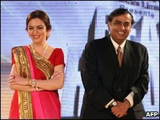 Indian industrialist Mukesh Ambani (R) poses with his wife Neeta Ambani at an awards ceremony in Mumbai March 10, 2010.