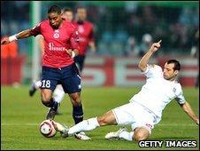 Javier Mascherano chases down Franck Beria