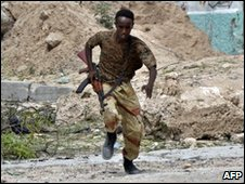 Somali government fighter taking cover