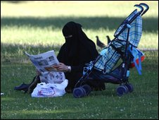 Muslim woman in a park (generic)