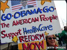 Protesters display placards supporting US President Barack Obama's healthcare reform during a demonstration in Washington, DC, on March 9, 2010