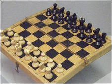 Chess set made from the wood of a Red Cross parcel crate from a private collection