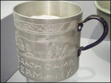 """Mug made by Byll Balcombe, inscribed with """"V"""" for Victory, from a private collection"""