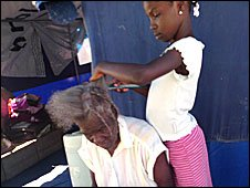 Braiding hair. Photo by Christine Finn