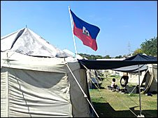 A Haitian flag flying from a tent. Photo by Chrisinie Finn