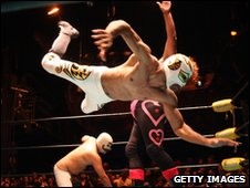 Masked wrestlers in action in Mexicio