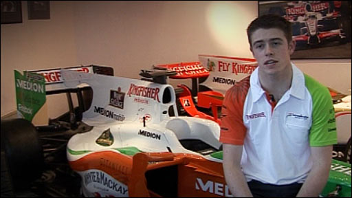 Scottish driver Paul Di Resta with a Formula One car
