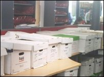Cartel Client Review customer files in boxes