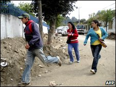Residents of Constitucion run from their homes after an aftershock, 11 March    