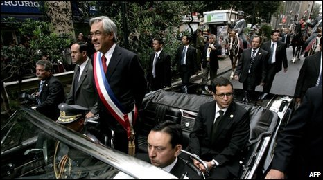 Chilean President Sebastian Pinera (with sash) parades through Santiago, 11 March
