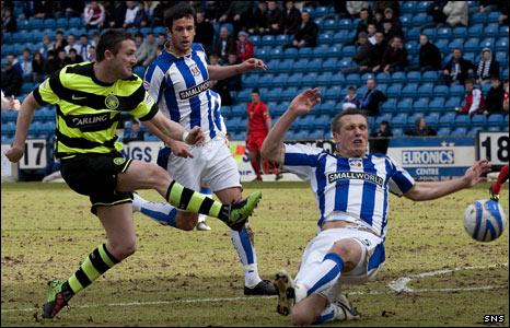 Celtic striker Robbie Keane shoots